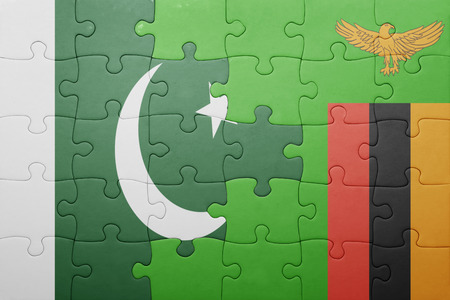 zambian flag: puzzle with the national flag of zambia and pakistan . concept Stock Photo