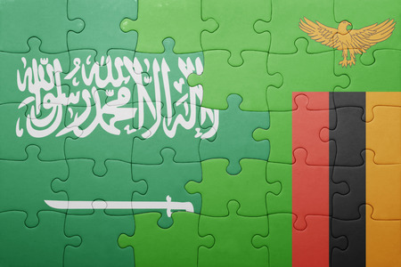 zambian flag: puzzle with the national flag of zambia and saudi arabia . concept