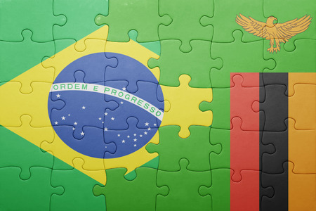 zambian flag: puzzle with the national flag of zambia and brazil . concept