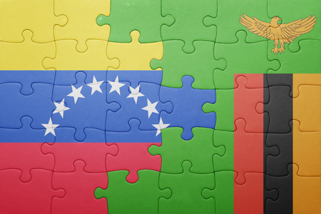 zambian: puzzle with the national flag of zambia and venezuela . concept