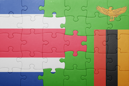 costa rican flag: puzzle with the national flag of zambia and costa rica . concept Stock Photo