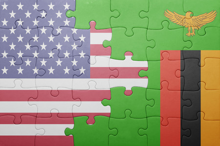 zambian flag: puzzle with the national flag of zambia and united states of america . concept Stock Photo