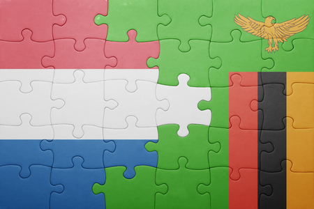 zambian: puzzle with the national flag of zambia and netherlands . concept Stock Photo