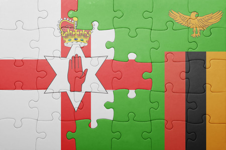 northern african: puzzle with the national flag of zambia and northern ireland . concept