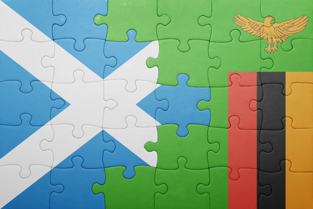 zambian flag: puzzle with the national flag of zambia and  scotland. concept