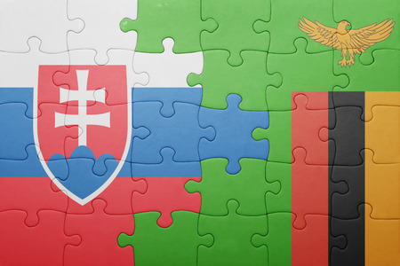 zambian flag: puzzle with the national flag of zambia and slovakia . concept