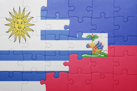 port au prince: puzzle with the national flag of haiti and uruguay .concept Stock Photo