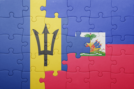 port au prince: puzzle with the national flag of haiti and barbados .concept