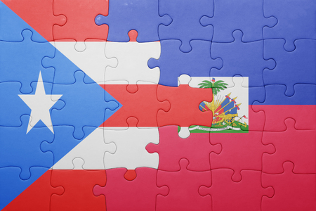port au prince: puzzle with the national flag of haiti and puerto rico .concept Stock Photo