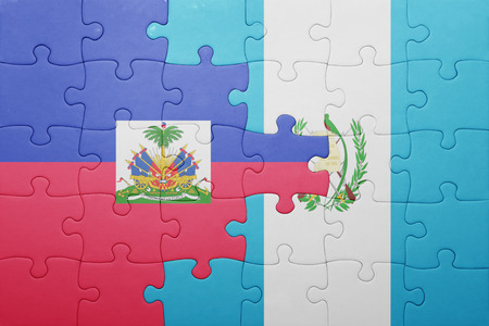 port au prince: puzzle with the national flag of guatemala and haiti .concept