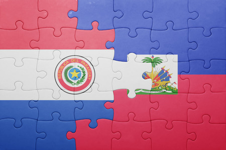 puzzle with the national flag of haiti and paraguay .concept
