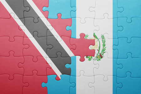 national flag trinidad and tobago: puzzle with the national flag of guatemala and trinidad and tobago .concept
