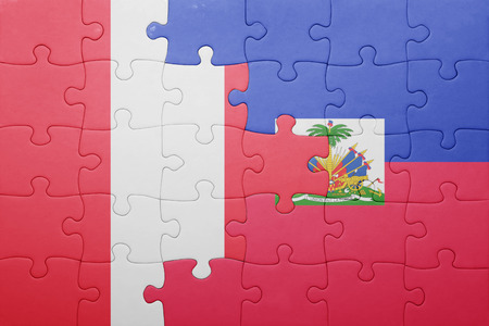 lima region: puzzle with the national flag of haiti and peru .concept
