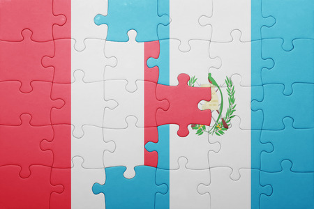 lima region: puzzle with the national flag of guatemala and peru .concept