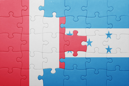 lima region: puzzle with the national flag of honduras and peru .concept