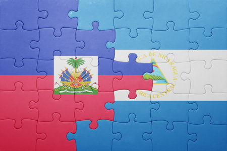 port au prince: puzzle with the national flag of nicaragua and haiti .concept Stock Photo