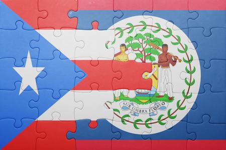 bandera de puerto rico: puzzle con la bandera nacional de Belice y .concept Puerto Rico Foto de archivo