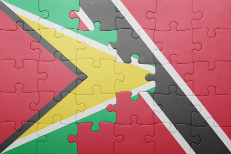 national flag trinidad and tobago: puzzle with the national flag of trinidad and tobago and guyana .concept Stock Photo