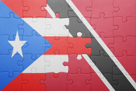 national flag trinidad and tobago: puzzle with the national flag of trinidad and tobago and puerto rico .concept Stock Photo