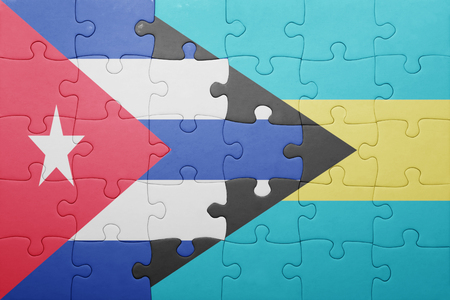banderas americanas: puzzle with the national flag of bahamas and cuba .concept Foto de archivo