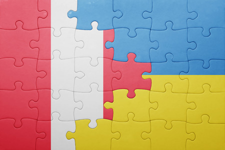 lima region: puzzle with the national flag of ukraine and peru . concept