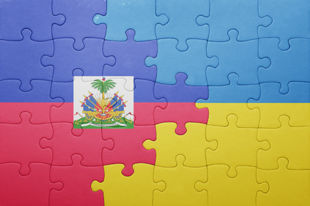 port au prince: puzzle with the national flag of ukraine and haiti . concept