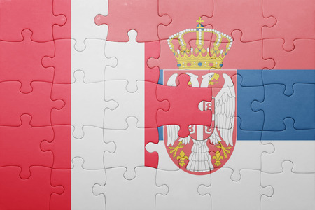 lima region: puzzle with the national flag of peru and serbia . concept Stock Photo