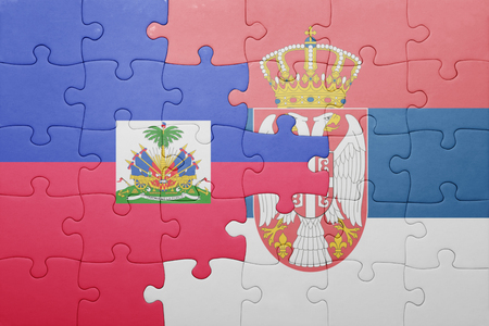 port au prince: puzzle with the national flag of haiti and serbia . concept