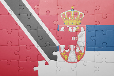 national flag trinidad and tobago: puzzle with the national flag of trinidad and tobago and serbia . concept