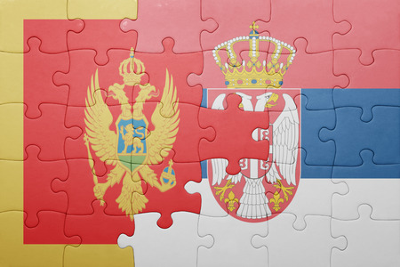 serbia and montenegro: puzzle with the national flag of montenegro and serbia . concept