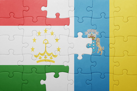 economy of tajikistan: puzzle with the national flag of canary islands and tajikistan . concept Stock Photo