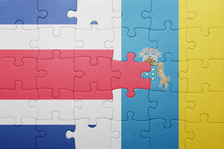 costa rican flag: puzzle with the national flag of canary islands and costa rica . concept