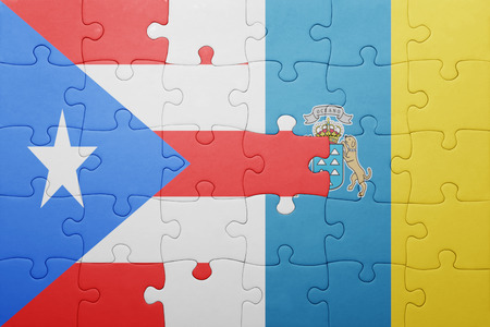 puerto rican flag: puzzle with the national flag of canary islands and puerto rico . concept