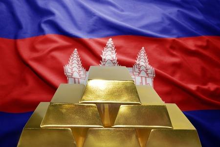 cambodian: shining golden bullions on the cambodian flag background Stock Photo