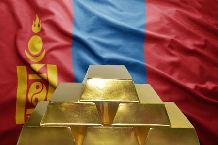 mongolian: shining golden bullions on the mongolian flag background