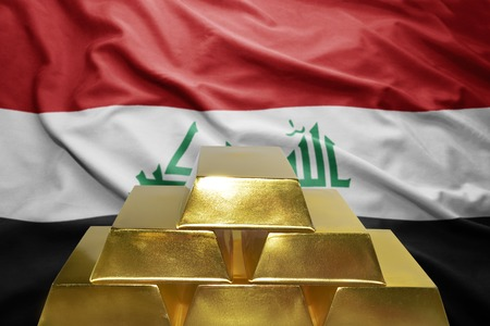 middle east crisis: shining golden bullions on the iraqi flag background