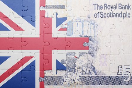 gb pound: puzzle with the national flag of great britain and scottish banknote . concept
