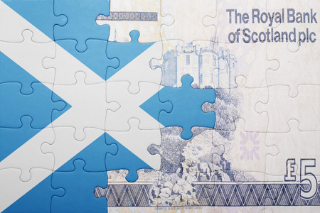 gb pound: puzzle with the national flag of scotland and scottish banknote . concept