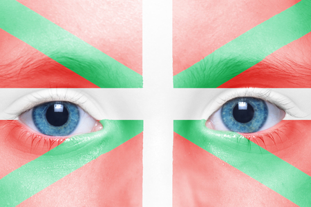 basque woman: childs face with basque country flag