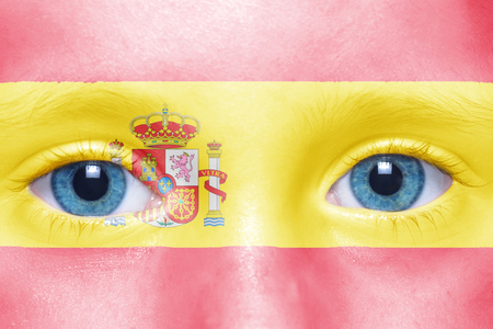 spanish flag: childs face with spanish flag Stock Photo