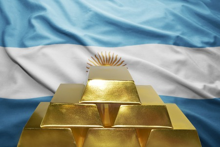 argentinean: shining golden bullions on the argentinean flag background