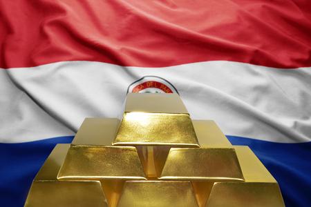 paraguayan: shining golden bullions on the paraguayan flag background Stock Photo