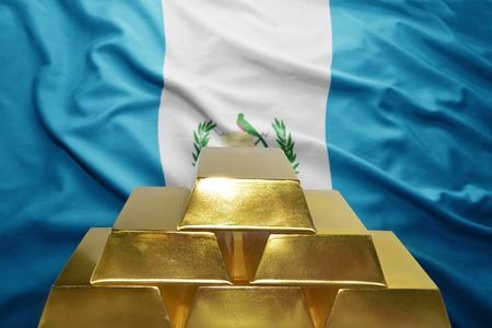 guatemalan: shining golden bullions on the guatemalan flag background