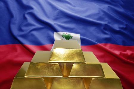 haitian: shining golden bullions on the haitian flag background Stock Photo