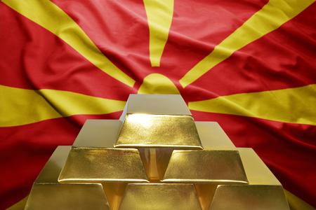 macedonian flag: shining golden bullions on the macedonian flag background