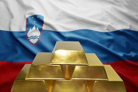 slovenian: shining golden bullions on the slovenian flag background