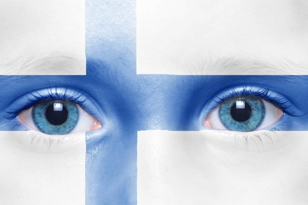 finnish: childs face with finnish flag Stock Photo