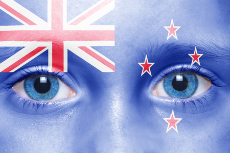 new zealand flag: humans face with new zealand flag Stock Photo