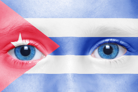humans face with cuban flag Stock Photo
