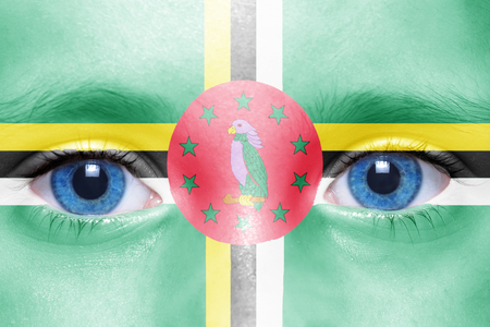 dominica: humans face with dominica flag